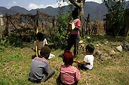 = Children playing zapatist guerrilla in San Cristobal  Chiapas  Mexico    /// enfants jouant à la guérilla Zapatiste à San Cristobal  Chiapas  Mexique  +