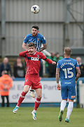 Liam Donnelly (Hartlepool United) rises above Gary Liddle (Carlisle United) to win the header during the EFL Sky Bet League 2 match between Hartlepool United and Carlisle United at Victoria Park, Hartlepool, England on 14 April 2017. Photo by Mark P Doherty.