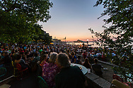 Patrons listen to live music on the Memorial Union Terrace on August 16, 2013.