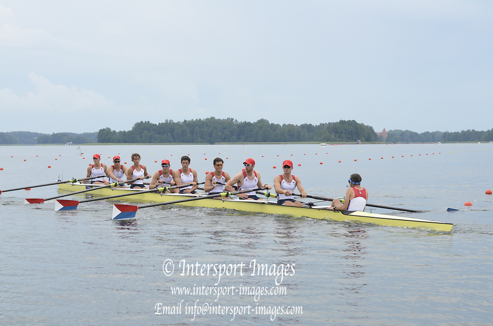 Trackai. LITHUANIA.  USA BM8+.  move away from the start in their morning heat in the men's Eight on. 2012 FISA U23 Rowing Championships, Lake Galve.   14:13:42 Thursday 12/07/2012 [Mandatory credit: Peter Spurrier/Intersport Images]..Rowing, U23, 2012.