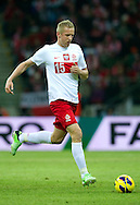 Kamil Glik of Poland controls the ball during the 2014 World Cup Qualifying Group H soccer match between Poland and San Marino at National Stadium in Warsaw on March 26, 2013...Poland, Warsaw, March 26, 2013...Picture also available in RAW (NEF) or TIFF format on special request...For editorial use only. Any commercial or promotional use requires permission...Photo by © Adam Nurkiewicz / Mediasport
