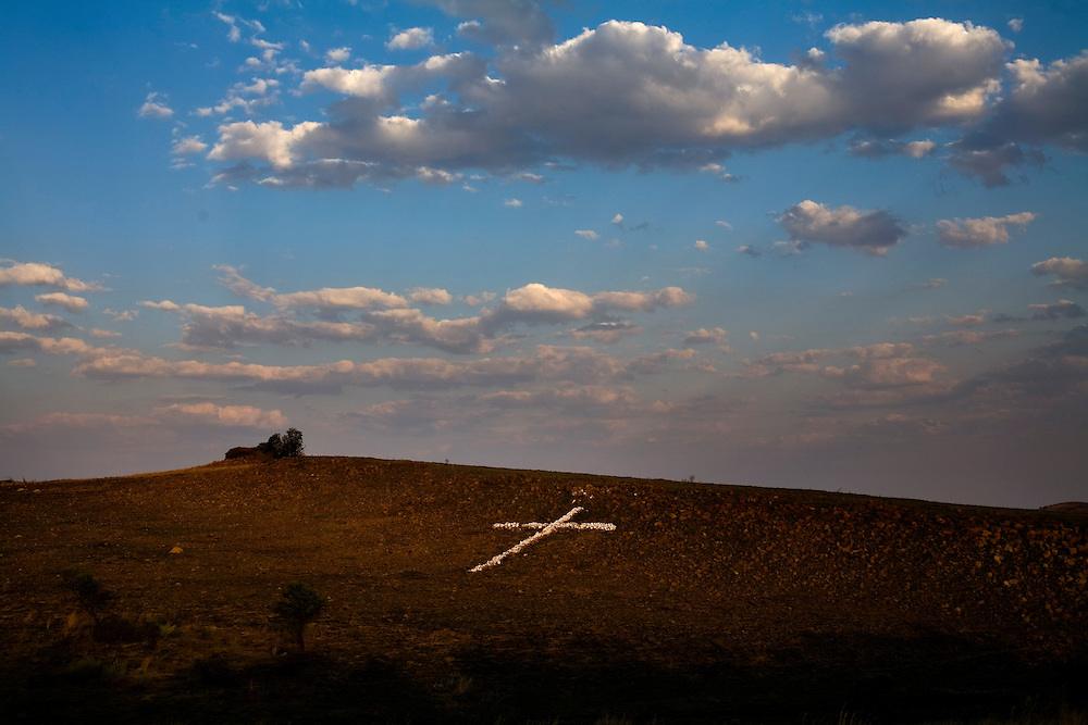A cross is made of stones on a hill near Carletonville, a gold mining community. South African Gold miners are particularly vulnerable to contracting TB because of the small, poorly ventilated work and living conditions, high rates of HIV and high rates of silicosis, a lung disease often found in miners that increases the chance of catching TB.