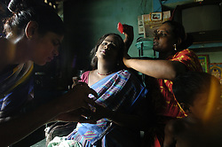 G. Velvish,27, right, brush hair of her transgender sisters at her hut in Chennai, India. <br />