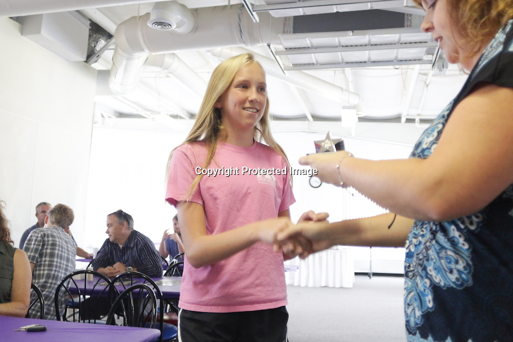 Camden Stohl accepts an award from Star News Editor Sherry Jones for the 15 Under 15 project Sunday September 14, 2014 at Jungle Rapids in Wilmington, N.C. (Jason A. Frizzelle)
