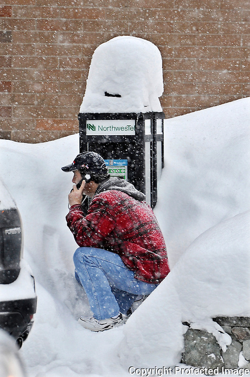 Ian Stewart/Yukon News<br /> Heavy snowfall earlier this week buried a payphone on Main Street in Whitehorse. More than double the average snowfall hit southern Yukon in December.