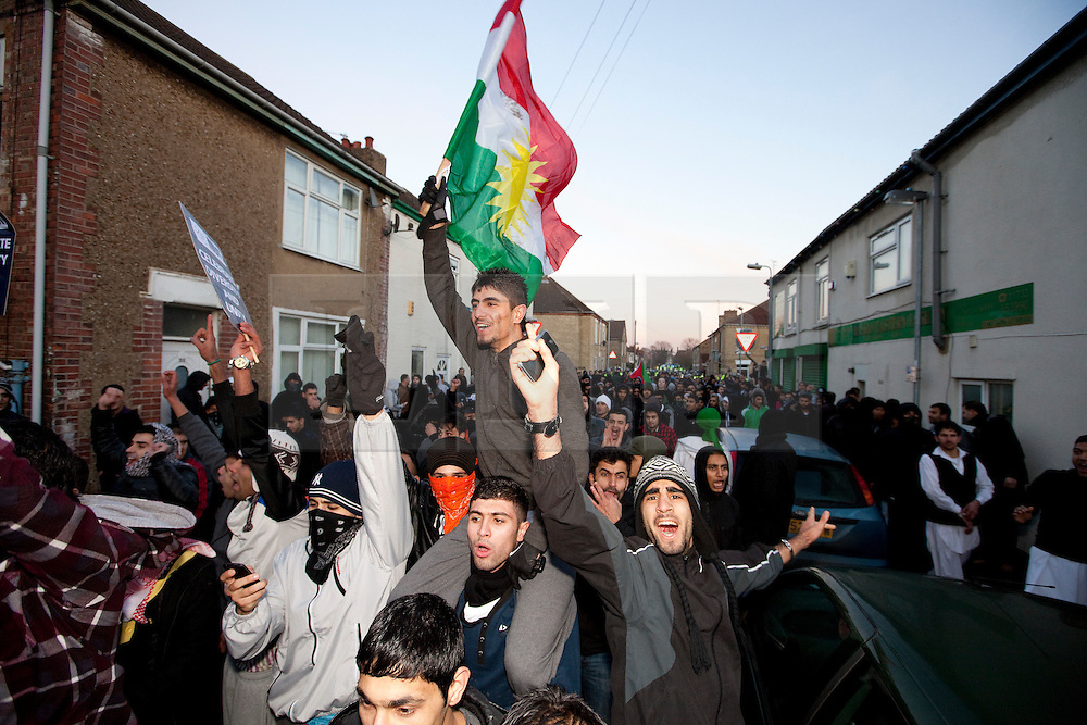 © under license to London News Pictures. 11/12/2010. Continuing their protests in towns and cities across the UK, the English Defence League protest against militant Islam in Peterborough. Muslim counter-protesters were led back through the streets to the local mosque.