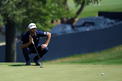 August 10, 2018 - St. Louis, Missouri, United States - Dustin Johnson lines up a putt on the 9th green during the second round of the 100th PGA Championship at Bellerive Country Club. (Credit Image: © Debby Wong via ZUMA Wire)