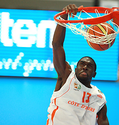 An Ivory Coast player scores with a slamdunk. France v Ivory Coast, On the road to London Tour, Basketball friendly, Palais des Sport, 29th June 2012/