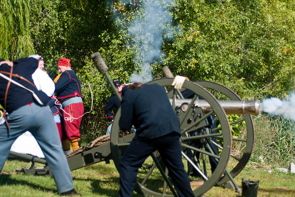 Lathan Goumas | The Bay City Times..Josh Tuzas and Nicole Johnston fire a cannon during the River of Time at Veterans Park in Bay City, MI., on Saturday September 24, 2011. The couple was married earlier in the day at the event.