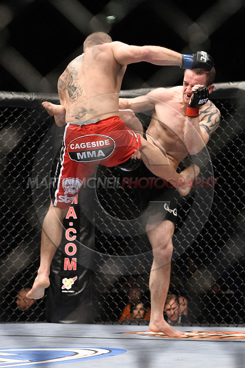 "LONDON, ENGLAND, JUNE 7, 2008: Jess Liaudin (left) and Paul Taylor trade kicks  during ""UFC 85: Bedlam"" inside the O2 Arena in Greenwich, London on June 7, 2008."