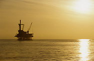 One off shore oil rig at sunset in the Santa Barbara Channel, California, USA.