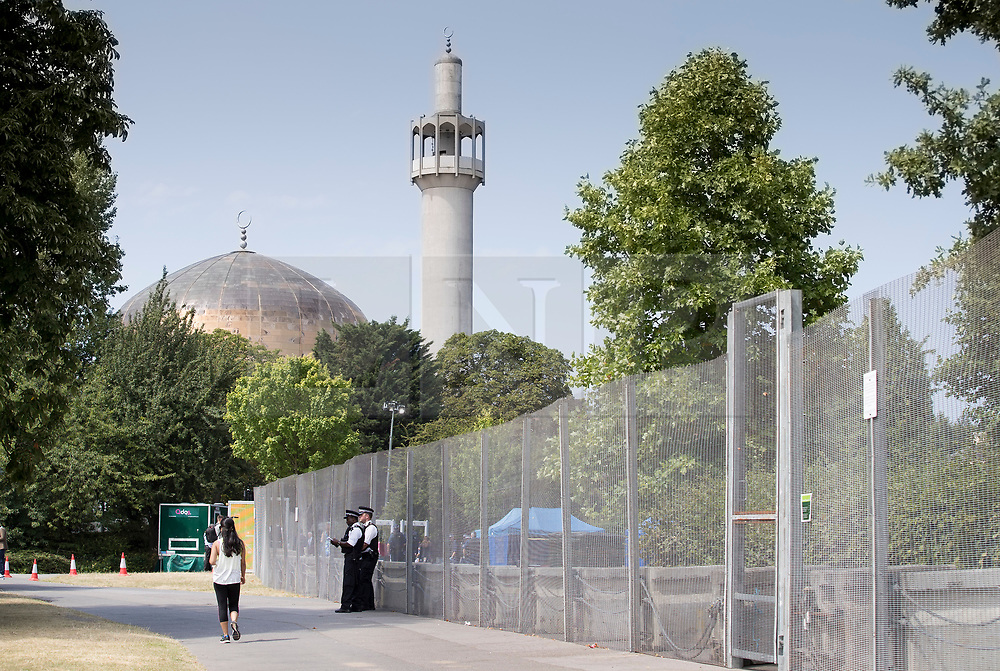 © Licensed to London News Pictures. 12/07/2018. London, UK. Police stand guard at closed off section of Regent's Park, near to Regent's Park Mosque, surrounding the US Ambassador's residence where President Trump will stay later.  Photo credit: Peter Macdiarmid/LNP