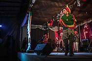 Singer from the capital of Addis Ababa, backed by photos of Haile Selassie I (Ras Tafari), performs reggae music at the headquarters of Twelve Tribes of Israel.  Shashemene, Ethiopia.