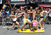 Pride marchers with the Greater Fort Lauderdale Convention & Visitors Bureau entertain spectators at the New York Gay Pride Parade, Sunday, June 29, 2014.   (Photo by Diane Bondareff/Invision for Greater Fort Lauderdale Convention & Visitors Bureau/AP Images)