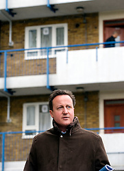 Leader of the Conservative Party David Cameron visits the Ocean Estate in Stepney, east London where he was shown around by 'London Citizens' Shahin Ahmed and Matthew Bolton (out of shot) who are trying to improve the estate for local residents, Wednesday March 31, 2010. Photo By Andrew Parsons / i-Images.