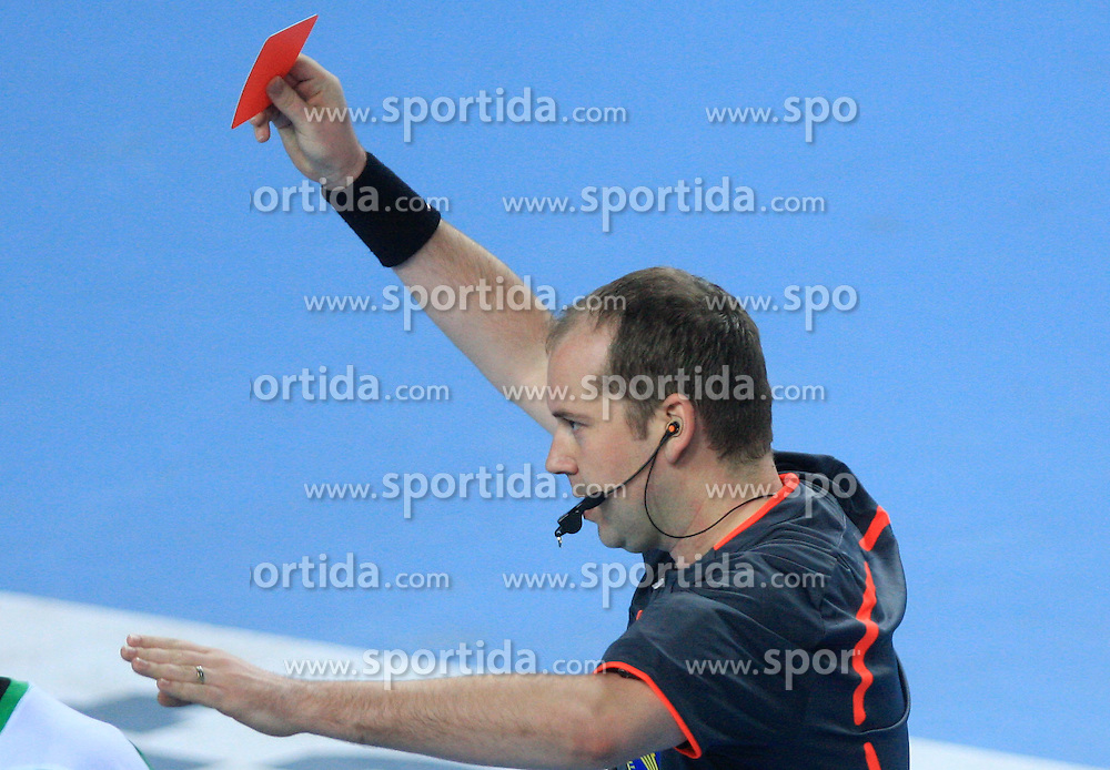 Referee shows red card during 21st Men's World Handball Championship preliminary Group C match between National teams of Tunisia and Algeria, on January 22, 2009, in Arena Varazdin, Varazdin, Croatia.  (Photo by Vid Ponikvar / Sportida)