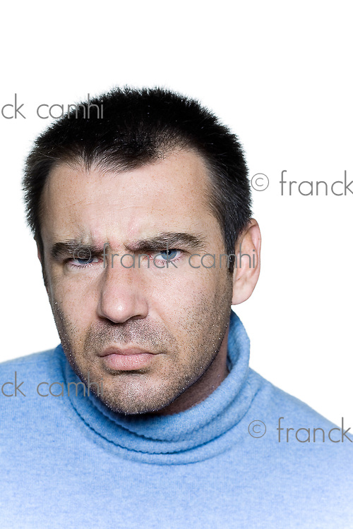 expressive portrait on isolated background of a stubble man,