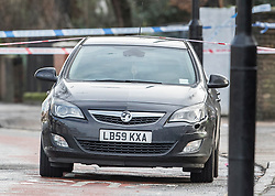 © Licensed to London News Pictures. 22/01/2018. London, UK. A Vauxhall car with a damaged front bumper (R) sits inside a police cordon Romford Road after a shooting incident. Roads are closed after a man was shot in the head last night. Photo credit: Peter Macdiarmid/LNP