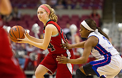 Bridgeport guard Kaitlin Smith (24) looks to pass the ball to a teammate against Fairmont Senior during a first round game at the Charleston Civic Center.