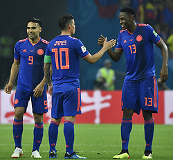 KAZAN, June 24, 2018  Colombia's James Rodriguez (C) and Yerry Mina (R) celebrate after the 2018 FIFA World Cup Group H match between Poland and Colombia in Kazan, Russia, June 24, 2018. Colombia won 3-0. (Credit Image: © He Canling/Xinhua via ZUMA Wire)
