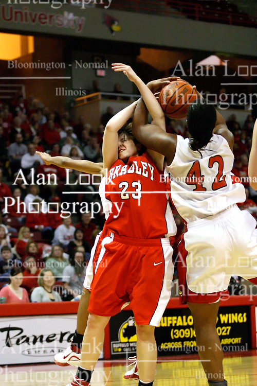 28 January 2007: Devyn Flanagan struggles for the ball with LaShawn Johnson. Before a record crowd or nearly 4200, the Bradley Braves were defeated by the conference leading (9-0) Redbirds of Illinois State University by a score of 55-47 at Redbird Arena in Normal Illinois.