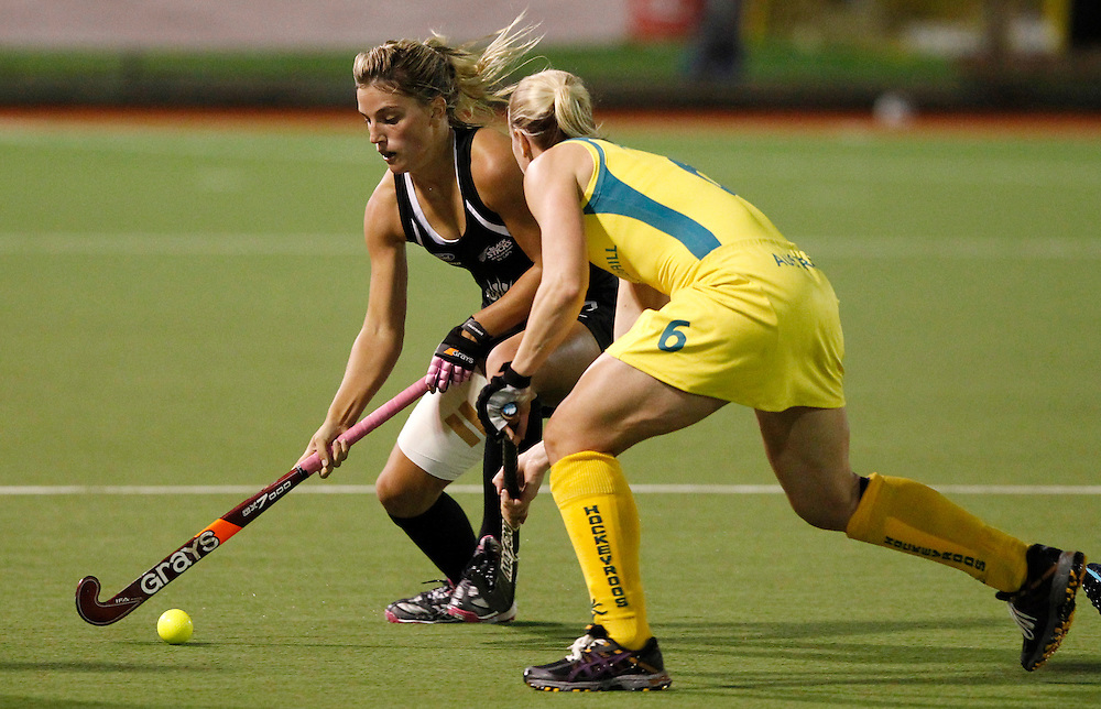 New Zealand's Gemma Flynn, left, looks to get past Australia's Megan Rivers during their four nations hockey final at North Harbour Hockey Stadium, Auckland, New Zealand, Monday, April 16, 2012. Credit:SNPA / Ben Campbell..