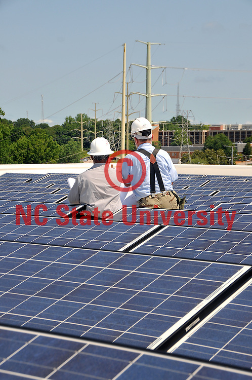 Solar panel experts discuss new solar field on the roof of the Keystone Science Center.