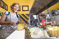 Portrait of young woman working in diner