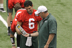 June 12, 2012; Florham Park, NJ, USA; New York Jets quarterback Mark Sanchez (6) and offensive coordinator Tony Sparano during New York Jets Minicamp at the Atlantic Health Training Center.