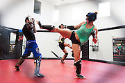 UFC bantamweight Holly Holm spars with UFC flyweight Matheus Nicolau of Brazil at Jackson Wink MMA in Albuquerque, New Mexico on June 9, 2016.