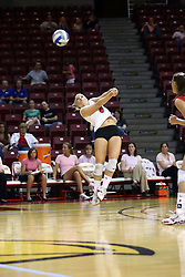 11 October 2008: Kasey Mollerus does some acrobatics to pull out a dig during a match between the Bulldogs of Drake University and the Redbirds of Illinois State University.  The Redbirds took the match against the Bulldogs 3 sets to none on Doug Collins Court inside Redbird Arena on the campus of Illinois State University in Normal Illinois.