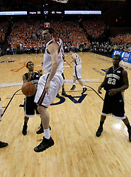 Virginia's Jason Cain reacts after throwing down a slam against Wake Forest.  The Virginia Cavaliers defeated the Wake Forest Demon Decons 88-76 at the John Paul Jones Arena in Charlottesville, VA on January 21, 2007.
