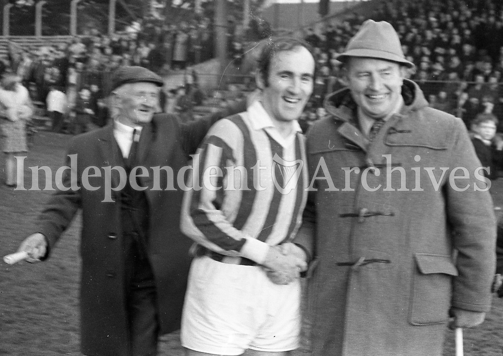 1271-186<br /> Nicky Rackard (right) the great Wexford full-forward congratulates Kilkenny's Eddie Keher after he had beaten Nicky's all time scoring record for a single year's inter-county hurling by eleven points at Kilkenny yesterday. 05/12/71 PIC E.G.  <br /> <br />  (Part of the Independent Newspapers Ireland/NLI collection.)