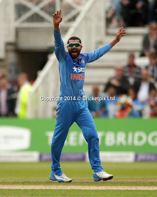 Bowler Ravindra Jadeja has Joe Root stumped by wicket keeper Mahendra Singh Dhoni during the third Royal London One Day International between England and India at Trent Bridge, Nottingham. Photo: Graham Morris/www.cricketpix.com (Tel: +44 (0)20 8969 4192; Email: graham@cricketpix.com) 300814