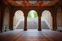 Visitor looking at map at the Bethesda Terrace