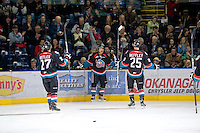 KELOWNA, CANADA, NOVEMBER 23: Tyrell Goulbourne #12, Jessey Astles #27 and Colton Heffley #25 of the Kelowna Rockets celebrate a goal against the Prince George Cougars visit the Kelowna Rockets  on November 23, 2011 at Prospera Place in Kelowna, British Columbia, Canada (Photo by Marissa Baecker/Shoot the Breeze) *** Local Caption *** Tyrell Goulbourne; Jessey Astles; Colton Heffley;