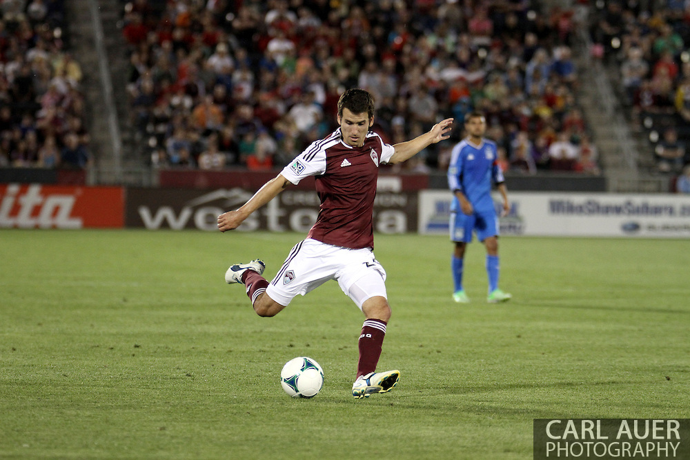 June 15th, 2013 - Colorado Rapids midfielder Nathan Sturgis (24) winds up for a shot on goal in second half of action in the MLS match between San Jose Earthquake and the Colorado Rapids at Dick's Sporting Goods Park in Commerce City, CO