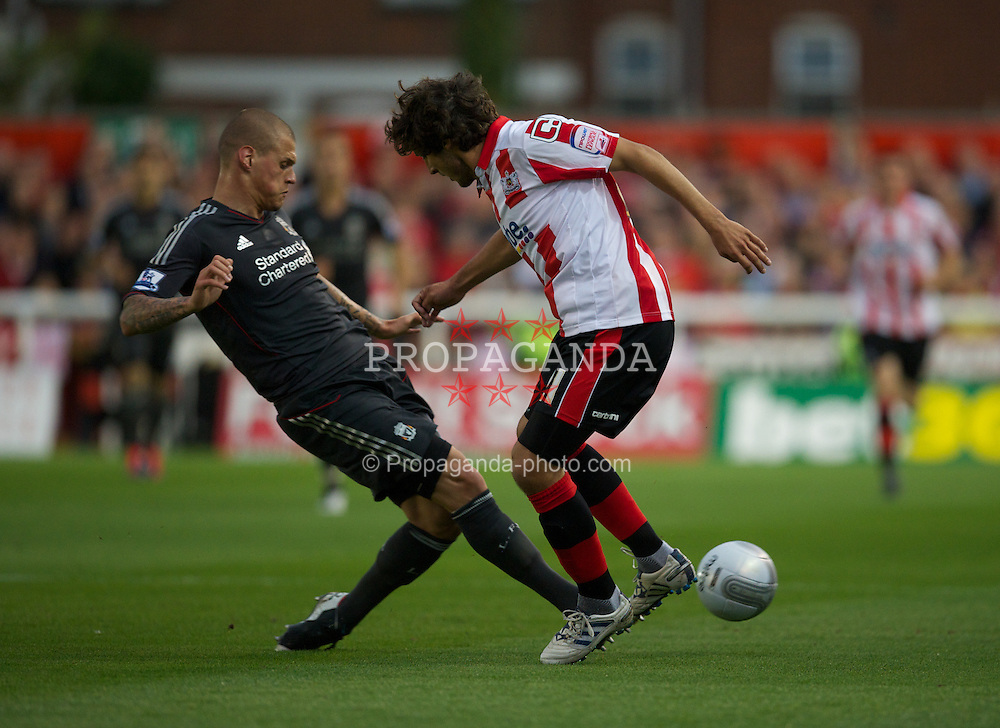 EXETER, ENGLAND - Wednesday, August 24, 2011: Liverpool's Martin Skrtel in action against Exeter City during the Football League Cup 2nd Round match at St James Park. (Pic by David Rawcliffe/Propaganda)