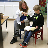 Lauren Wood | Buy at photos.djournal.com<br /> Volunteer Sherry Jenkins shakes hands with second grader Ethan McDonald after he read a book about snakes aloud Thursday morning at Joyner Elementary School.