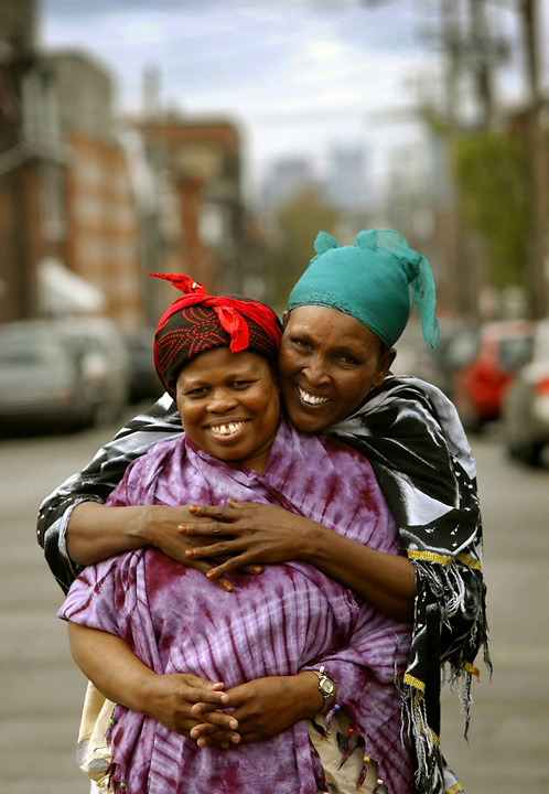 Somalis Ralia Derow (front) and Fatuma Abshir (back) near their home in Lawrenceville.  Derow, who is a Bantu, and Abshir , is a Marehan , first met in Daadab refugee camp in Kenya in 1992 and were reunited in Pittsburgh.