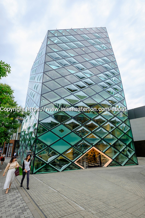 Exterior of glass walled Prada flagship store in Aoyama Tokyo Japan