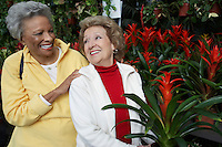 Two senior women in garden center