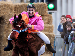 "© under licence to London News Pictures 28/11/2010 today picture. Birmingham`s wackiest Christmas event, the annual Pantominme Horse Grand National. The event that sees riders and horses race up and down Broad Street in the City Centre jumping over and even Through straw bales. Picture shows Joel Hicks on his horse ""Viagra"" who came last in his race..Picture credit: Dave Warren/London News Pictures..."