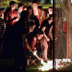 SUNY Geneseo students place candles in the opening of a lacrosse goal in memory of fellow student Alex Davis following a Candlelight Vigil on May 8, 2014.