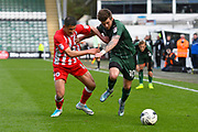 Noor Husin (16) of Accrington Stanley battles for possession with Graham Carey (10) of Plymouth Argyle during the EFL Sky Bet League 2 match between Plymouth Argyle and Accrington Stanley at Home Park, Plymouth, England on 1 April 2017. Photo by Graham Hunt.