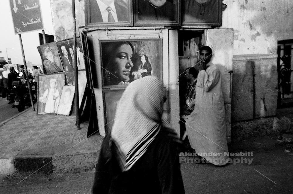 Mansura, Egypt 1998 - Portrait painters kiosk on street corner along the Nile.