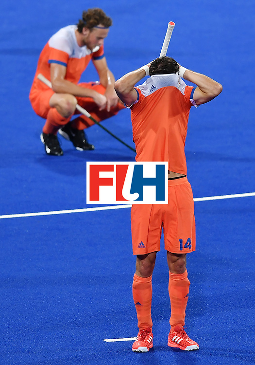 Netherland's Robbert Kemperman covers his head after missing the men's semifinal field hockey Belgium vs Netherlands match of the Rio 2016 Olympics Games at the Olympic Hockey Centre in Rio de Janeiro on August 16, 2016. / AFP / MANAN VATSYAYANA        (Photo credit should read MANAN VATSYAYANA/AFP/Getty Images)