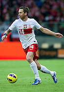 Jakub Wawrzyniak of Poland controls the ball during the 2014 World Cup Qualifying Group H soccer match between Poland and San Marino at National Stadium in Warsaw on March 26, 2013...Poland, Warsaw, March 26, 2013...Picture also available in RAW (NEF) or TIFF format on special request...For editorial use only. Any commercial or promotional use requires permission...Photo by © Adam Nurkiewicz / Mediasport