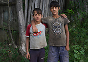 Two Roma boys pose for a portrait in the all-Roma village of Poiana Negustiorului in Bacau County, Romania.