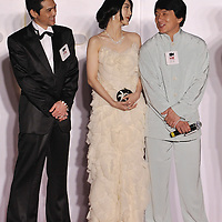 """HONG KONG - MARCH 22:  Hong Kong actor Jackie Chan (C), Chinese actresses Fan Bingbing and Japanese actor Masaya Kato attend the Opening Ceremony of the 33rd Hong Kong International Film Festival and the Gala Premiere of the opening films """"Shinjuku Incident """" at the Hong Kong Convention and Exhibition Centre on March 22, 2009 in Hong Kong.  Photo by Victor Fraile / studioEAST"""